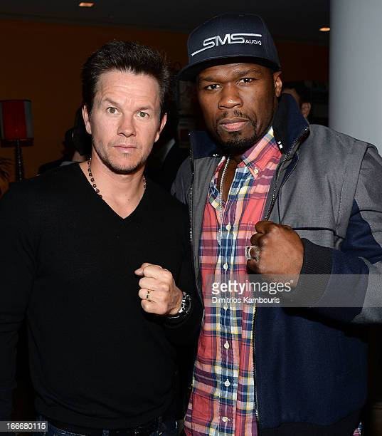 Actor Mark Wahlberg and Curtis '50 Cent' Jackson attend the Cinema Society and Men's Fitness screening of 'Pain and Gain' at the Crosby Street Hotel...