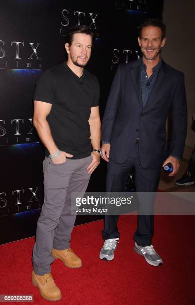 Actor Mark Wahlberg and director Peter Berg at CinemaCon 2017 The State of the Industry Past Present and Future and STX Films Presentation at The...