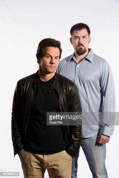 Actor Mark Wahlberg and former Navy SEAL Marcus Luttrell are photographed for USA Today on December 5 2013 in New York City PUBLISHED IMAGE