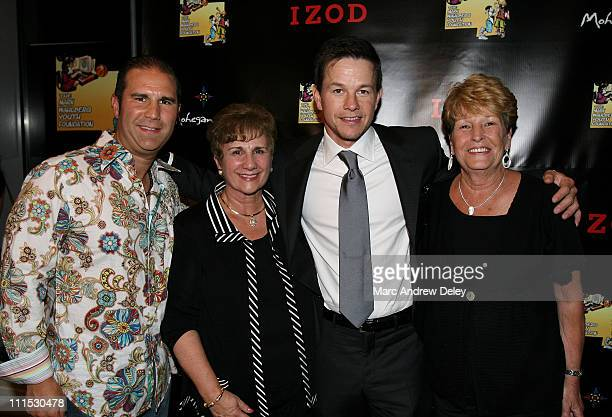 Actor Mark Wahlberg and his mother Alma Wahlberg with guests attend M Night Shyamalan's 'The Happening' After Party hosted by IZOD to Support The...