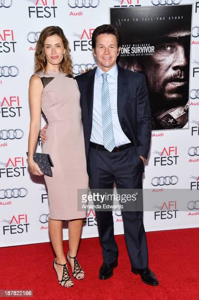 Actor Mark Wahlberg and his wife Rhea Durham arrive at the AFI FEST 2013 Presented By Audi 'Lone Survivor' premiere at TCL Chinese Theatre on...