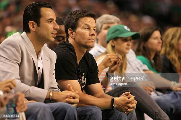Actor Mark Wahlberg and IZOD IndyCar driver Helio Castroneves attend Game Four of the Eastern Conference Finals between the Boston Celtics and the...