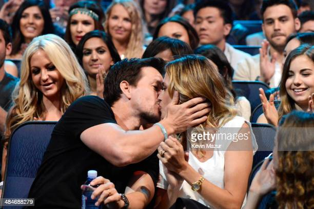 Actor Mark Wahlberg and Rhea Durham attend the 2014 MTV Movie Awards at Nokia Theatre LA Live on April 13 2014 in Los Angeles California