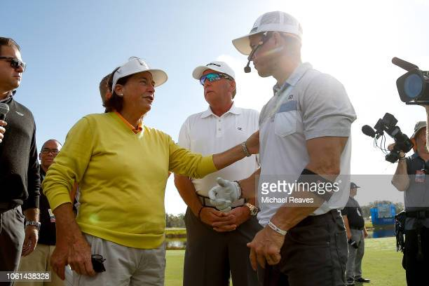 Actor Mark Wahlberg greets former LPGA golfer Amy Alcott during the CME Group charity event to benefit St Jude ChildrenÕs Research Hospital prior to...