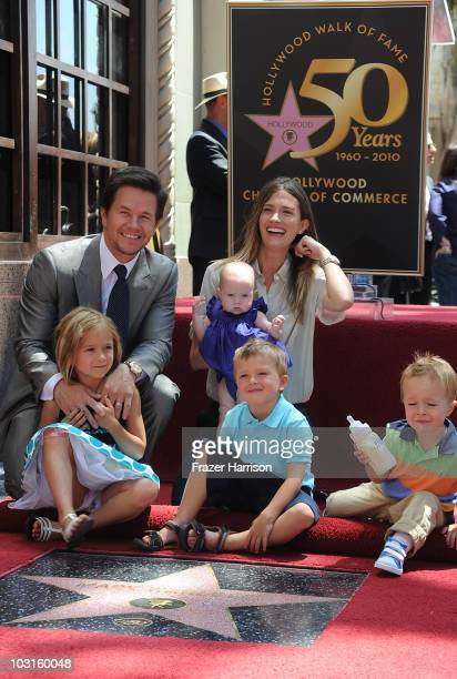 Actor Mark Wahlberg is honored on The Hollywood Walk Of Fame with the 2414th Star poses with his family wife Rhea Durham and their children Ella,...