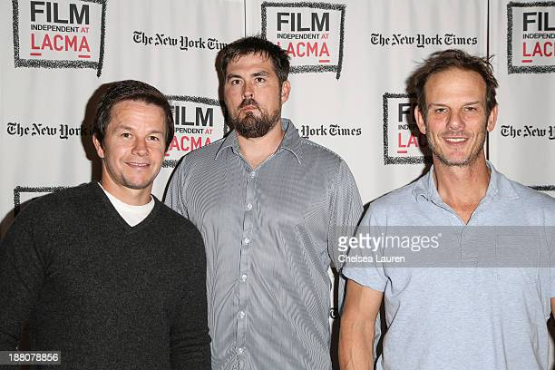 Actor Mark Wahlberg Marcus Luttrell and writer/director Peter Berg arrive at the Film Independent at LACMA screening and QA of 'Lone Survivor' at...