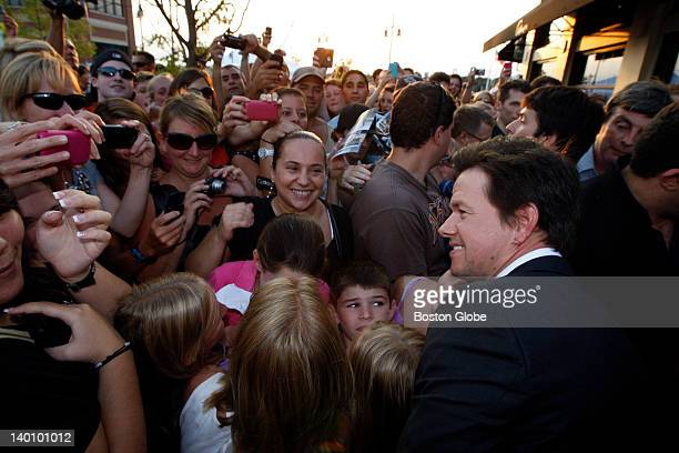 Actor Mark Wahlberg poses with fans outside the restaurant Alma Nove in Hingham where he is hosting a special advance screening of 'The Other Guys'...