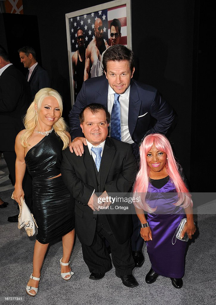 Actor Mark Wahlberg poses with his costars Elaine Ganc, Donnie Davis and Ali Chapman at the 'Pain & Gain' - Los Angeles Premiere held at TCL Chinese Theatre on April 22, 2013 in Hollywood, California.