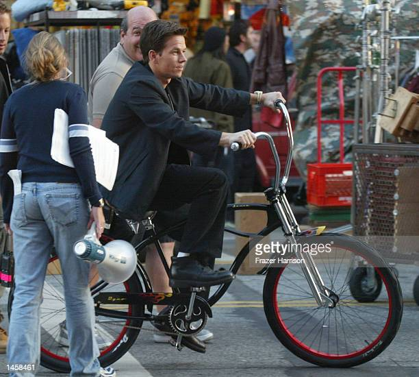 Actor Mark Wahlberg rides a bike on the set of The Italian Job on Hollywood Boulevard October 3 2002 in Hollywood California