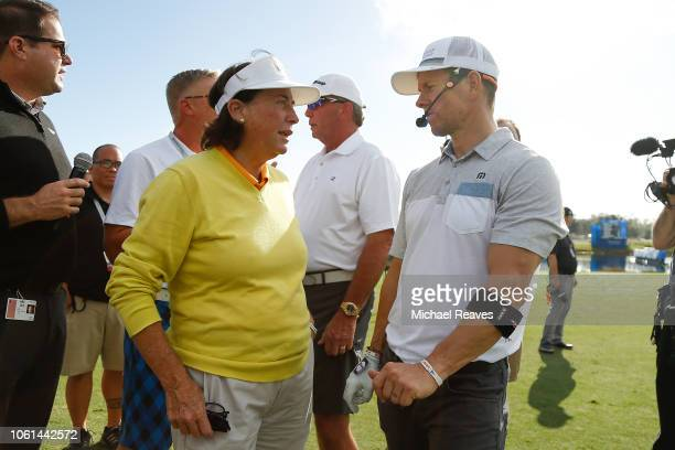 Actor Mark Wahlberg talks with former LPGA golfer Amy Alcott during the CME Group charity event to benefit St Jude Children's Research Hospital prior...