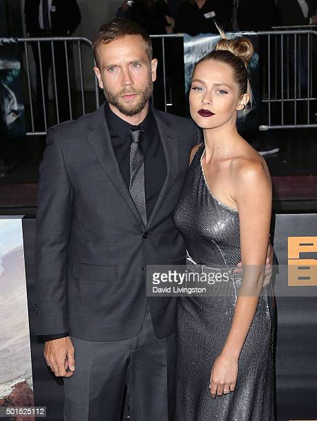 Actor Mark Webber and wife actress Teresa Palmer attend the premiere of Warner Bros Pictures' Point Break at TCL Chinese Theatre on December 15 2015...