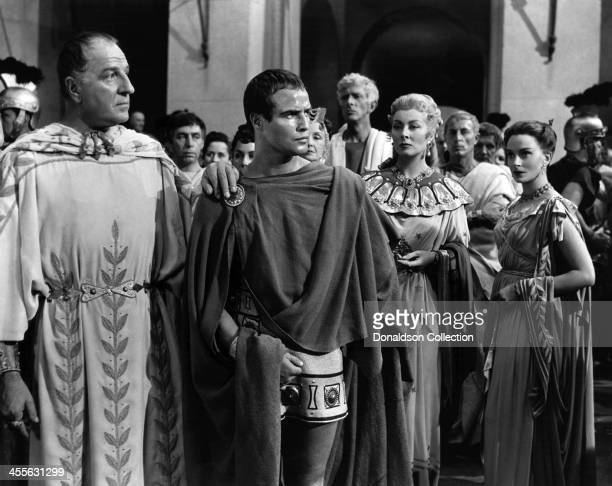 Actor Marlon Brando and Louis Calhern with Greer Garson and Deborah Kerr on the set of the movie 'Julius Caesar' which came out in 1953
