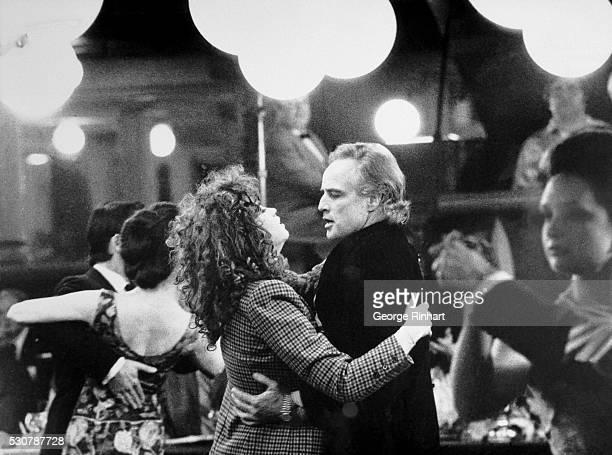 Actor Marlon Brando dances with actress Maria Schneider in the 1973 United Artists Film Last Tango in Paris Directed by Bernardo Bertolucci Undated...
