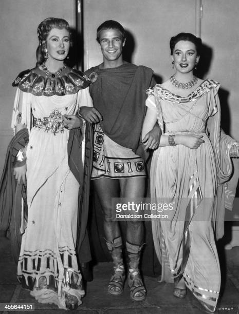 Actor Marlon Brando Greer Garson and Deborah Kerr pose for a portrait on the set of the movie 'Julius Caesar' which came out in 1953