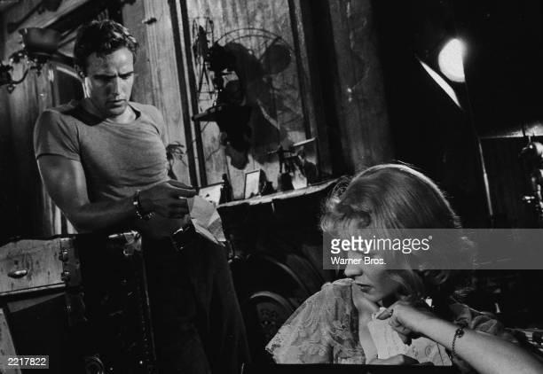 Actor Marlon Brando hands a tissue to Vivien Leigh in a still from the film, 'A Streetcar Named Desire,' directed by Elia Kazan, 1951.