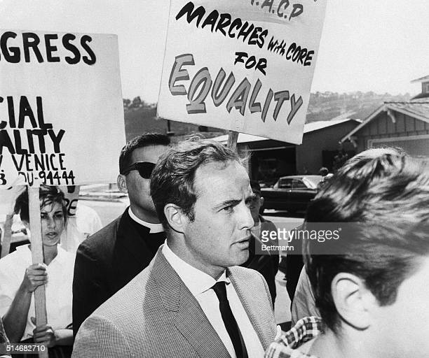 Actor Marlon Brando joins with marchers from CORE to protest an all-white housing area in Torrance, California. Police arrested 25 of the protestors...