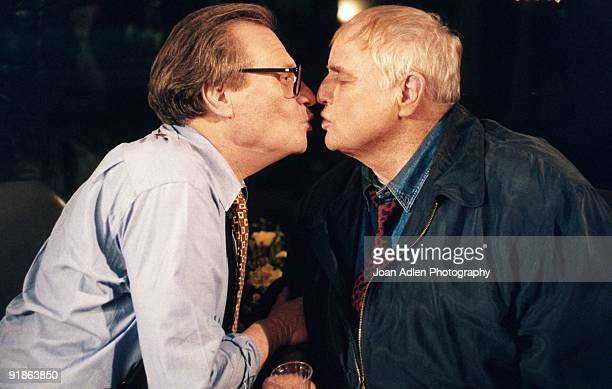Actor Marlon Brando plants one on talk show host Larry King during the taping of 'The Larry King Show' taped at Brando's house in Coldwater Canyon on...