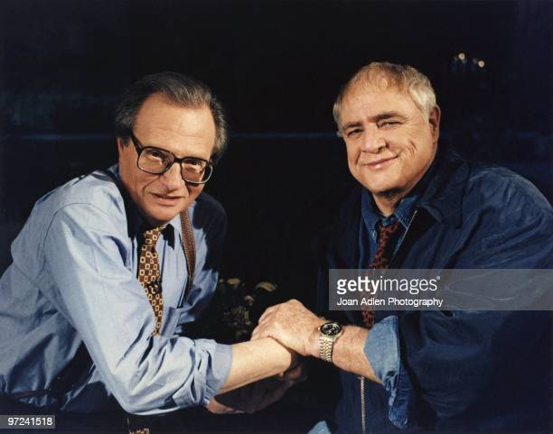 """Actor Marlon Brando plants one on talk show host Larry King during the taping of """"The Larry King Show' taped at Brando's house in Coldwater Canyon on..."""