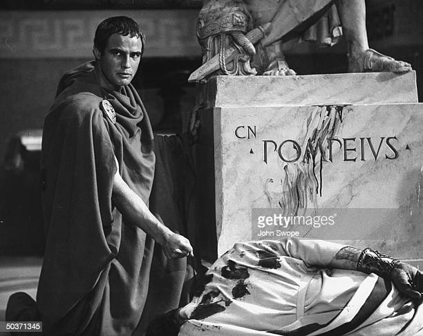 Actor Marlon Brando playing Mark Antony with the body of Julius Caesar while praising him in a scene from the movie version of Shakespeare's Julius...