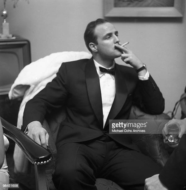 Actor Marlon Brando smokes a cigarette as he attends a party on February 24 1955 in Los Angeles California