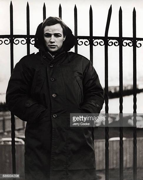 Actor Marlon Brando wears a heavy overcoat in Fort Lee New Jersey during the filming of his upcoming film On the Waterfront