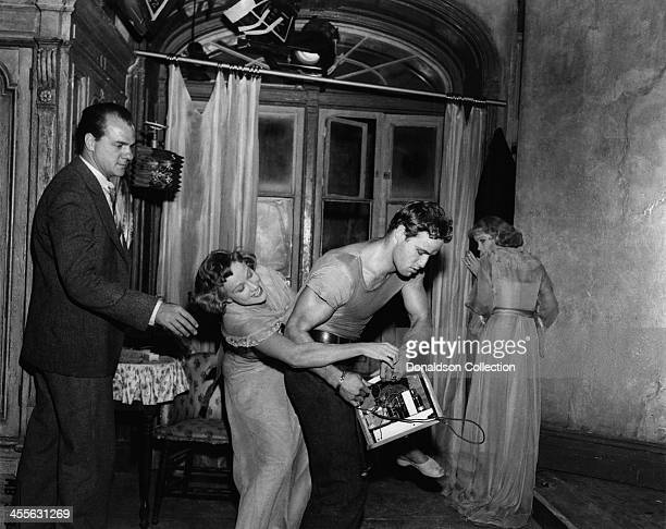Actor Marlon Brando wrestles with Kim Hunter while Karl Malden and Vivien Leigh watch, on the set of the movie 'A Streetcar Named Desire' which came...
