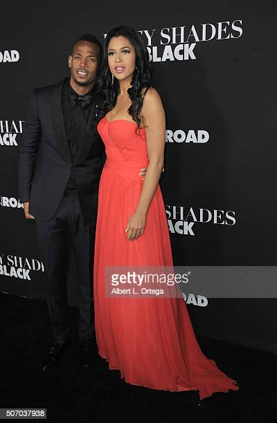 Actor Marlon Wayans and actress Kali Hawk arrive for the premiere of Open Roads Films' Fifty Shades Of Black held at Regal Cinemas LA Live on January...