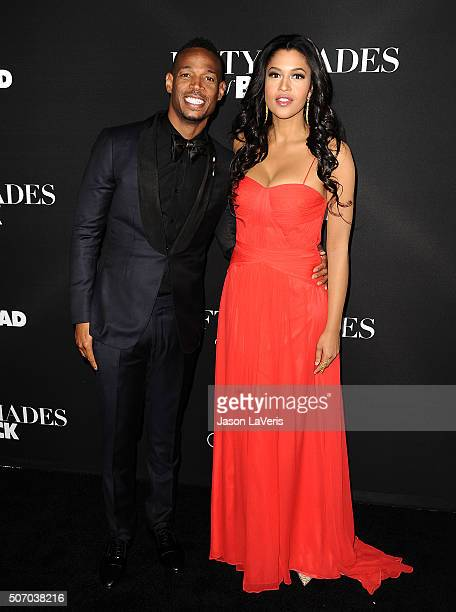 Actor Marlon Wayans and actress Kali Hawk attend the premiere of Fifty Shades of Black at Regal Cinemas LA Live on January 26 2016 in Los Angeles...