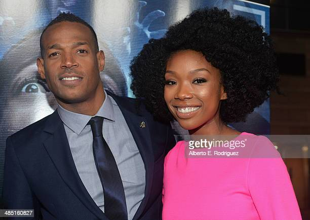Actor Marlon Wayans and singer Brandy Norwood arrive to the premiere of Open Road Films' 'A Haunted House 2' at Regal Cinemas LA Live on April 16...