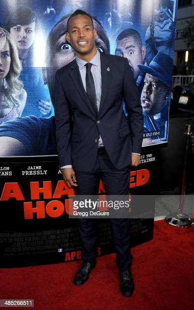 Actor Marlon Wayans arrives at the Los Angeles premiere of 'A Haunted House 2' at Regal Cinemas LA Live on April 16 2014 in Los Angeles California