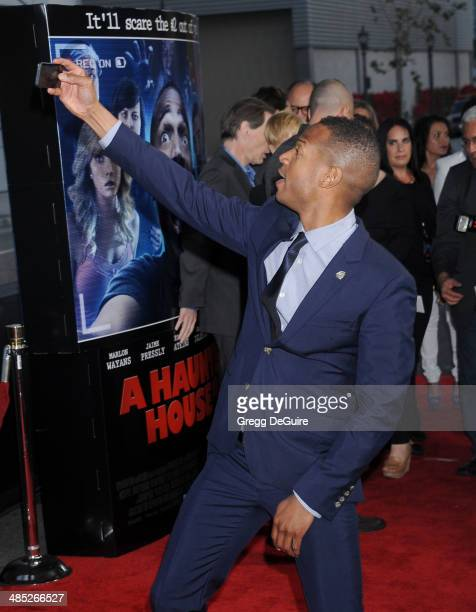 """Actor Marlon Wayans arrives at the Los Angeles premiere of """"A Haunted House 2"""" at Regal Cinemas L.A. Live on April 16, 2014 in Los Angeles,..."""
