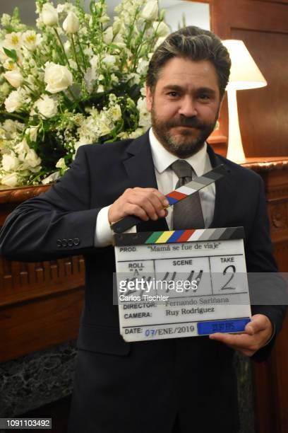 Actor Martin Altomaro poses for photos with a clapperboard during the filming of the movie 'Mama se fue de viaje' at Circulo Cubano de Mexico on...