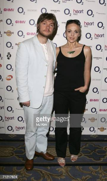 Actor Martin Freeman and girlfriend Amanda Abbington pose at the O2 Silver Clef Lunch an annual awards honouring songwriting and performance in aid...