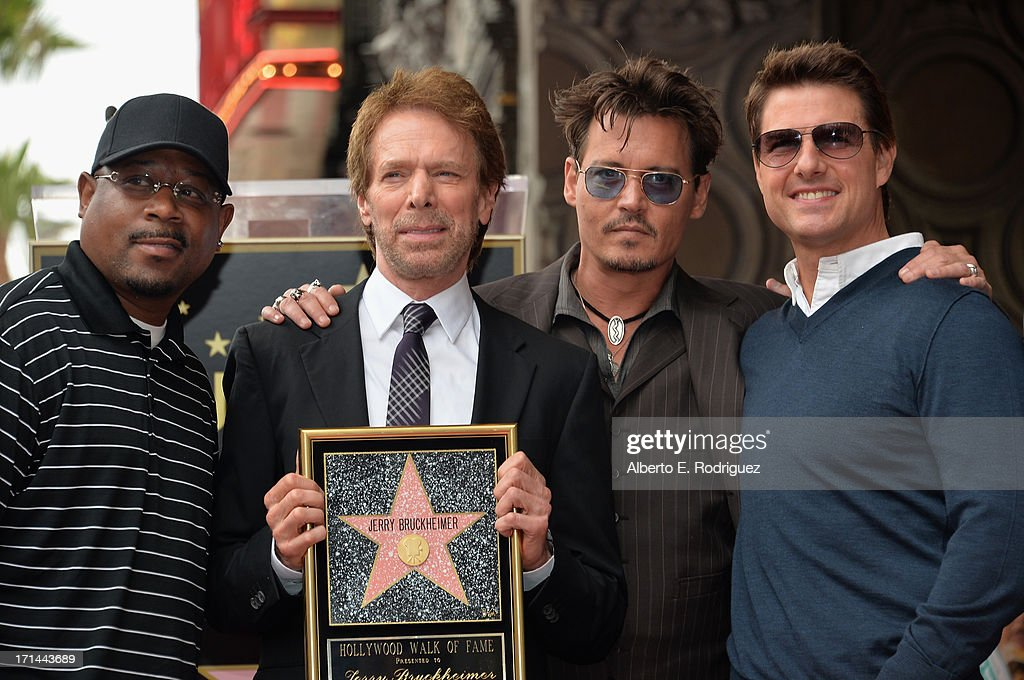 Actor Martin Lawerence, producer Jerry Bruckheimer, actors Johnny Depp and Tom Cruise attend Legendary Producer Jerry Bruckheimer Hollywood Walk of Fame Star Ceremony on the Hollywood Walk of Fame on June 24, 2012 in Hollywood, California.