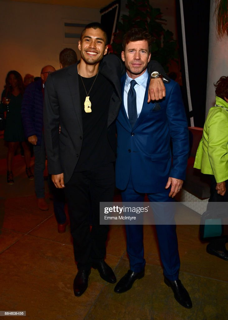 Actor Martin Sensmeier (L) and writer/director Taylor Sheridan attend a cocktail party for 'Wind River' at Circa 55 Restaurant on December 2, 2017 in Los Angeles, California.