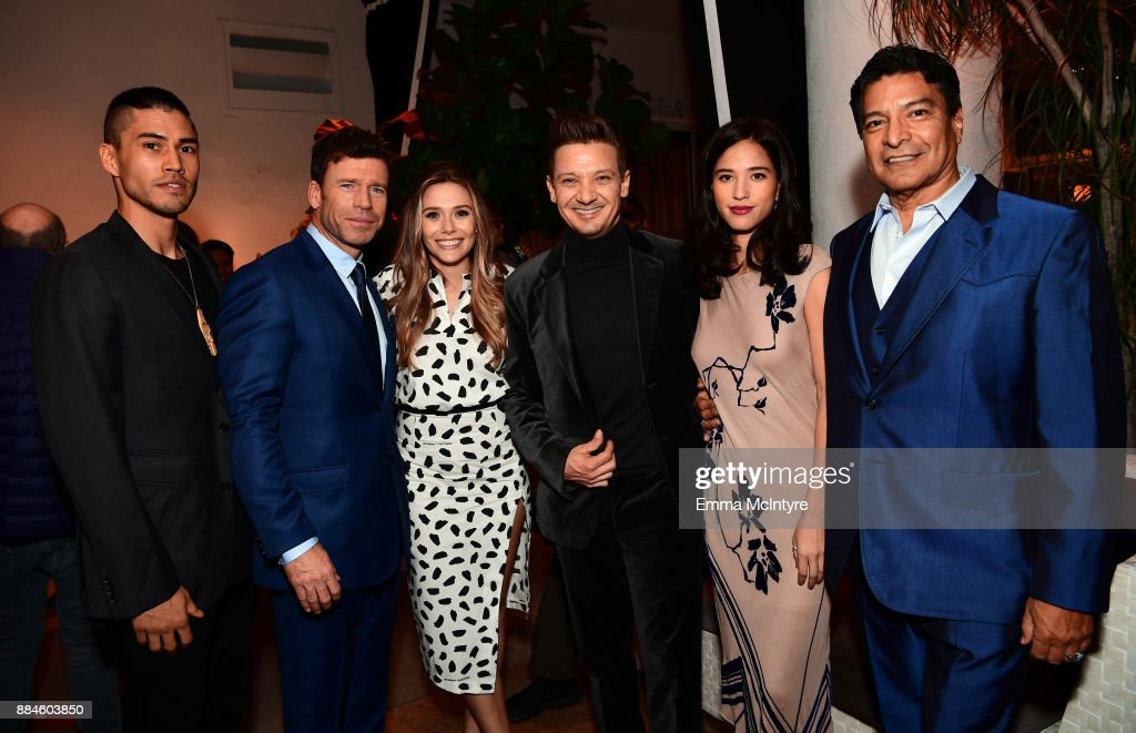 Actor Martin Sensmeier, writer/director Taylor Sheridan, actors Elizabeth Olsen, Jeremy Renner, Kelsey Asbille, and Gil Birmingham attend a cocktail party for 'Wind River' at Circa 55 Restaurant on December 2, 2017 in Los Angeles, California.