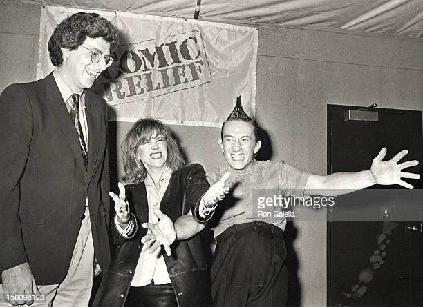 Actor Martin Short Harold Ramis and guest attending 'Comic Relief Benefit' on March 29 1986 at the Universal Amphitheater in Universal City California