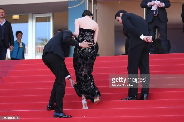 Actor Masahiro Higashide and director Ryusuke Hamaguchi assist Erika Karata with her dress at the screening of Asako I II during the 71st annual...