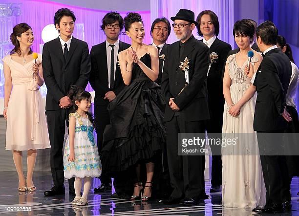Actor Masaki Okada , actress Mana Ashida , actress Yoshino Kimura , director Tetsuya Nakashima and actress Takako Matsu react on stage as their film...