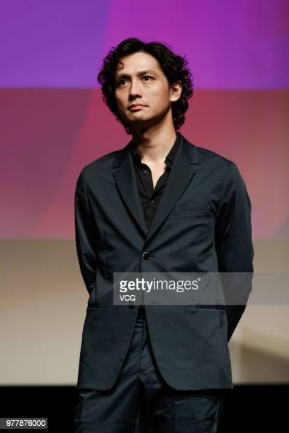 Actor Masanobu Ando attends a meeting of film 'Lenses on Her Heart' during the 21st Shanghai International Film Festival at Tianshan Cinema on June...