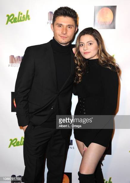 Actor Mateus Ward and actress Angela Ryan arrive for the Screening Of Relish held at Pacific Theatres at The Grove on January 24 2019 in Los Angeles...