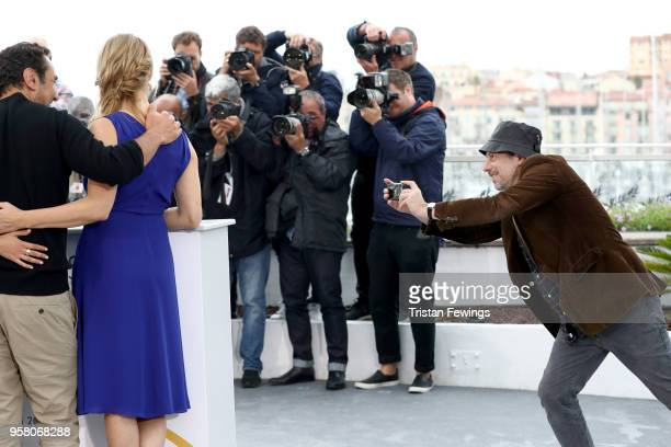 Actor Mathieu Amalric is seen taking a picture of fellow actors Gilles Lellouche and Virginie Efira during the 'Sink Or Swim ' Photocall during the...
