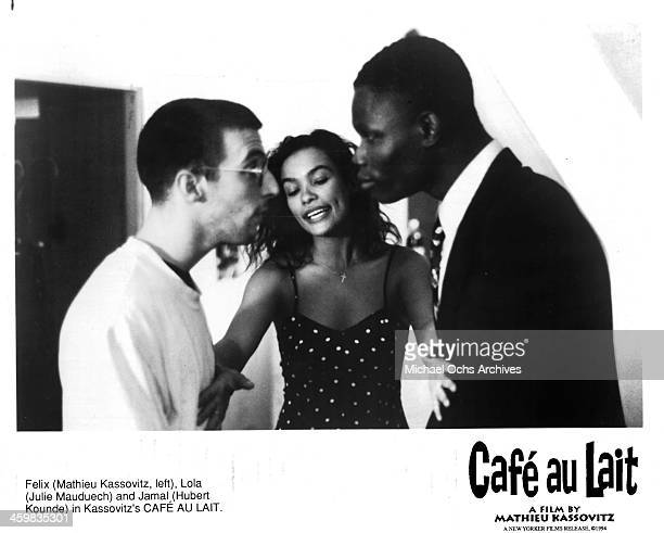 "Actor Mathieu Kassovitz, actress Julie Mauduech and Hubert Kounde on set of the movie "" Cafe au lait "" , circa 1993."