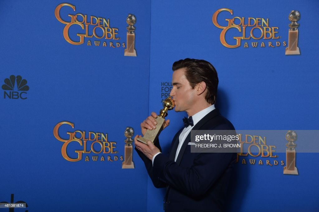 Actor Matt Bomer holds the award for Best Supporting Actor - Series, Mini-Series, TV Movie for his role in 'The Normal Heart', in the press room at the 72nd annual Golden Globe Awards, January 11, 2015 at the Beverly Hilton Hotel in Beverly Hills, California. AFP PHOTO / FREDERIC J BROWN / AFP PHOTO / Frederic J. BROWN