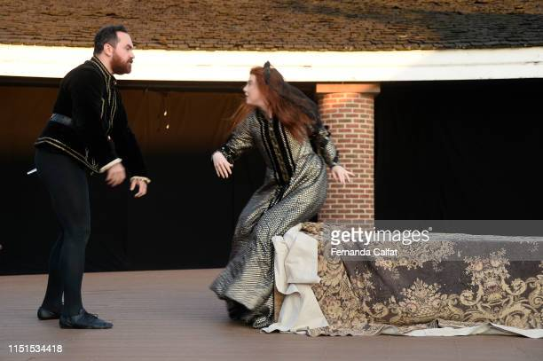 Actor Matt Carr Jr and actress Sid Parker onstage at Shakespeare Downtown Presents Hamlet at Castle Clinton National Monument Battery Park on June 22...