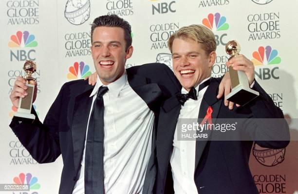 Actor Matt Damon and cowriter Ben Affleck pose with their Golden Globe award for Best Screenplay for 'Good Will Hunting' at the 55th Annual Golden...