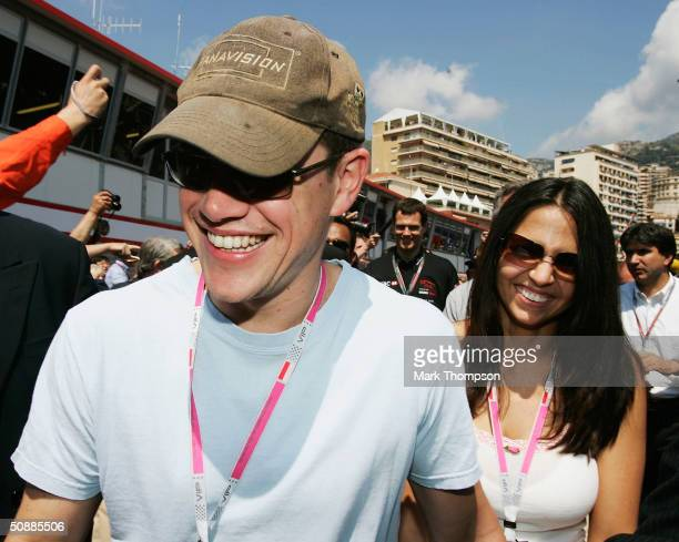 Actor Matt Damon and girlfriend Luciana Bozan pushes through the crowds outside the Jaguar garage as the official guests of Jaguar Racing after a...