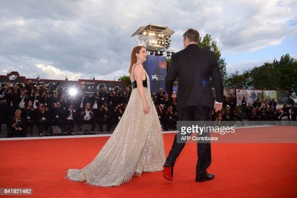 US actor Matt Damon and US actess Julianne Moore attend the premiere of the movie 'Suburbicon' presented out of competition at the 74th Venice Film...
