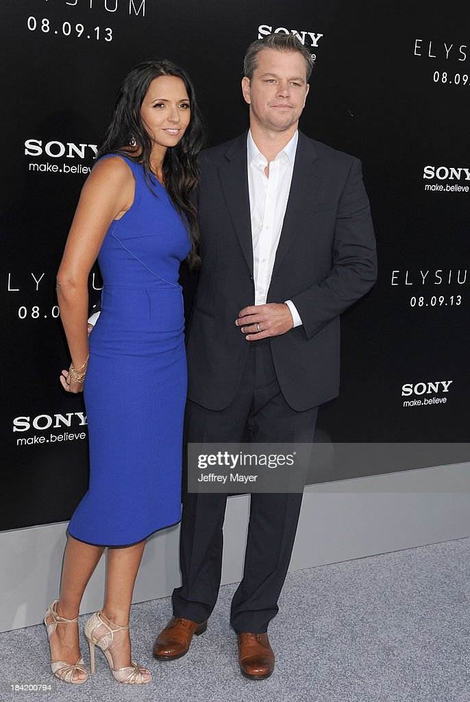 Actor Matt Damon (R) and wife Luciana Damon arrive at the Los Angeles premiere of 'Elysium' at Regency Village Theatre on August 7, 2013 in Westwood, California.