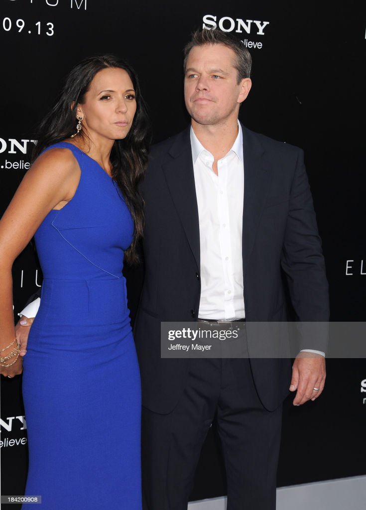Actor Matt Damon (R) and wife Luciana Damon arrive at the Los Angeles premiere of 'Elysium' at Regency Village Theatre on August 7, 2013 in Westwood, California.WESTWOOD, CA- AUGUST 07: Actor Matt Damon arrives at the Los Angeles premiere of 'Elysium' at Regency Village Theatre on August 7, 2013 in Westwood, California.
